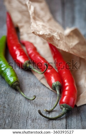 Red and green fresh chili pepper,shallow depth of field - stock photo