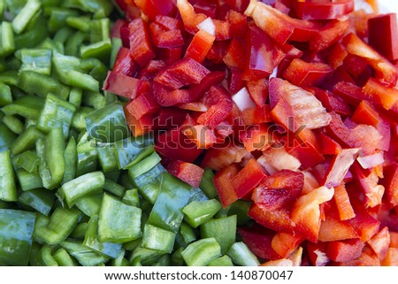 red and green peppers diced prepared for cooking - stock photo