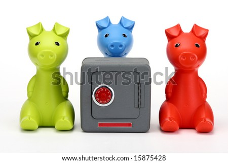 Red and Green Piggy banks guarding a combination safe with a Blue Piggy bank looking over the safe - stock photo