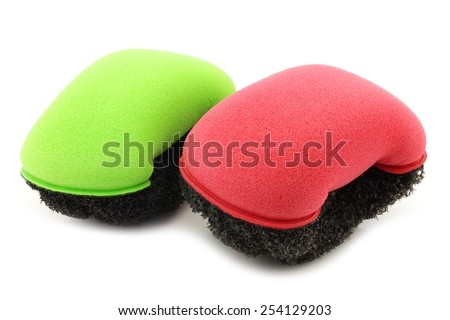 red and green plastic and foam abrasive pads on a white background - stock photo