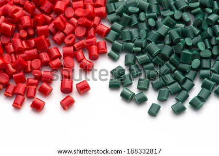 red and green plastic pellets for injection molding industry - stock photo