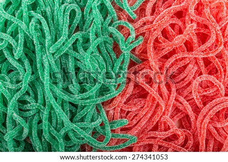 red and green rubber candies in the shape of a snake with sugar - stock photo