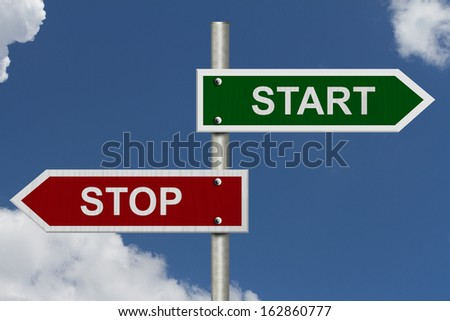 Red and green street signs with blue sky with words Stop and Start, Stop versus Start - stock photo