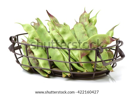 Red and green string beans on white background - stock photo