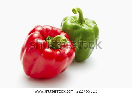 Red and green sweet pepper isolated on a white background  - stock photo