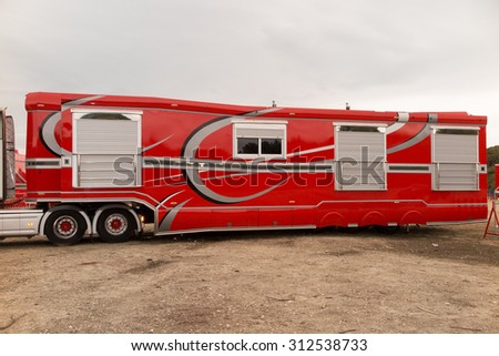 Red and grey american truck - stock photo