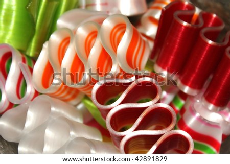 Red and orange ribbon candy closeup - stock photo