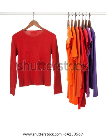 Red and purple casual shirts on wooden hangers, isolated on white. - stock photo