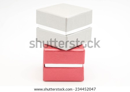 Red and silver hard paper box for gift or present as isolated objects on white background - stock photo
