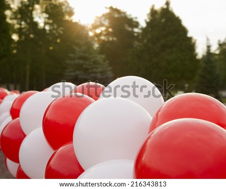 Red and white balloons decoration for party outside  - stock photo