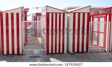 Red and white beach hut. - stock photo
