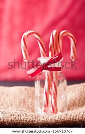 red and white candy cane in a jar - stock photo