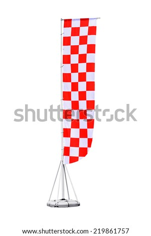 Red and white checkered flag on stand, also called beach flag, with path  - stock photo