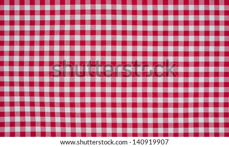 Red and white checkered tablecloth - stock photo
