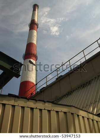 red and white chimney in the old plant - stock photo