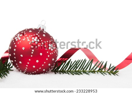 Red and white Christmas ball and ribbon with pine on white background - stock photo