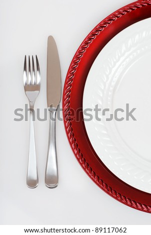 red and white Christmas place setting - stock photo