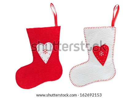 Red and White handmade Christmas stockings isolated on a white background. - stock photo