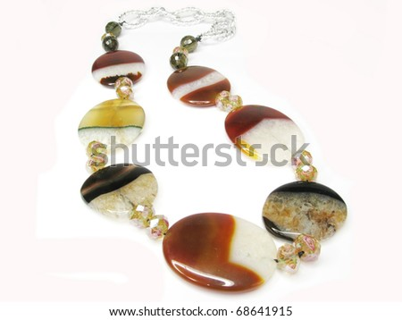 red and white large semigem agate beads isolated on white background - stock photo