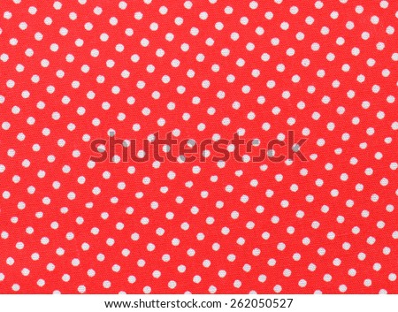 Red and white polka dot fabric - stock photo