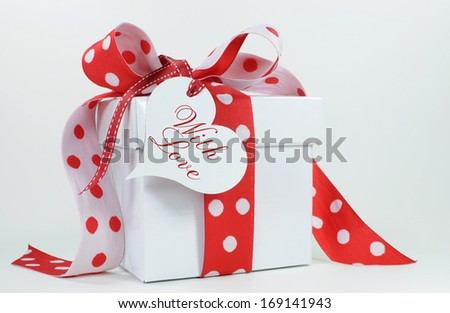 Red and white polka dot theme gift box present with heart shape gift tag, with love, for Christmas, Valentine, birthday, wedding or special occasion. - stock photo