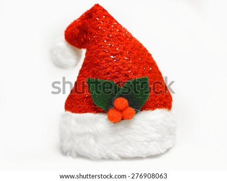 Red and white Santa Claus hat poinsettia Christmas Xmas holidays isolated on white background - stock photo