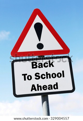Red and white triangular road sign with a Back to School Ahead concept against a partly cloudy sky background - stock photo