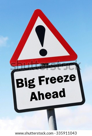 Red and white triangular road sign with a Big Freeze Ahead concept against a partly cloudy sky background - stock photo