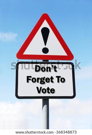 Red and white triangular road sign with a Don't Forget To Vote Ahead concept against a partly cloudy sky background - stock photo