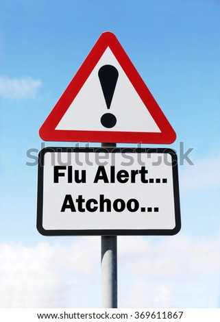 Red and white triangular road sign with a Flu Alert... Atchoo... Ahead concept against a partly cloudy sky background - stock photo