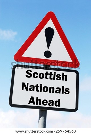 Red and white triangular road sign with a Scottish National Party ahead concept against a partly cloudy sky background - stock photo