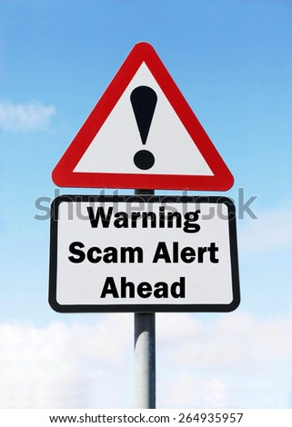 Red and white triangular road sign with a warning of a Scam Alert Ahead concept against a partly cloudy sky background - stock photo
