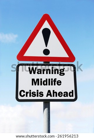 Red and white triangular road sign with warning of a Midlife Crisis Ahead concept against a partly cloudy sky background - stock photo