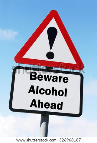 Red and white triangular road sign with warning to Beware of Alcohol  Ahead concept against a partly cloudy sky background - stock photo