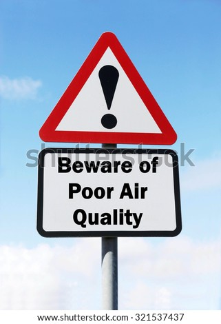 Red and white triangular road sign with warning to Beware of Poor Air Quality ahead concept against a partly cloudy sky background - stock photo