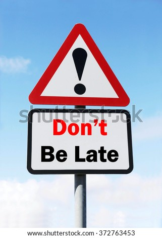 Red and White triangular warning road sign with a Don't Be Late concept against a partly cloudy sky background. - stock photo