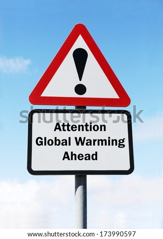 Red and white triangular warning road sign with a global warming concept against a partly cloudy sky background - stock photo