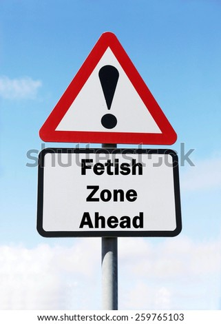 Red and white triangular warning road sign with a warning of a Fetish Zone ahead concept against a partly cloudy sky background - stock photo