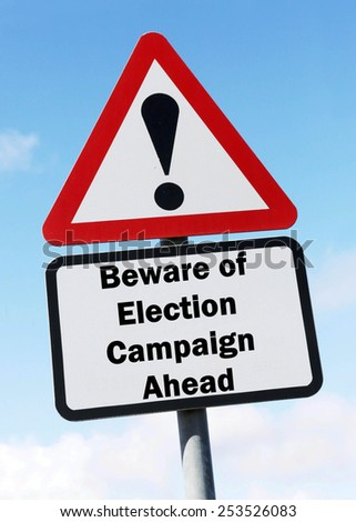 Red and white triangular warning road sign with a warning of Election Campaign Ahead concept against a partly cloudy sky background - stock photo