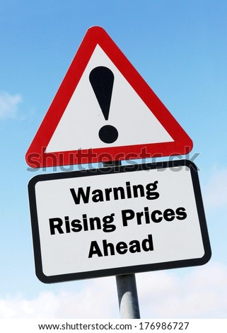 Red and white triangular warning road sign with a warning of rising prices ahead concept against a partly cloudy sky background  - stock photo