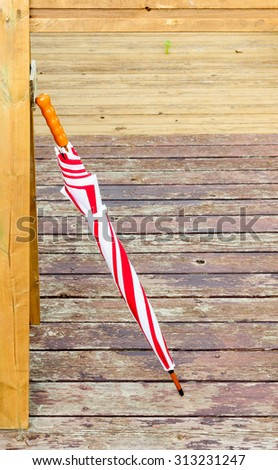 Red and White umbrella - stock photo