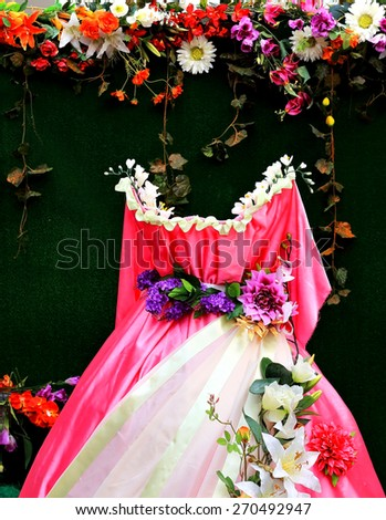 Red and white wedding dress decorated with flowers - stock photo