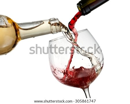 Red and white wine pouring in a glass - stock photo