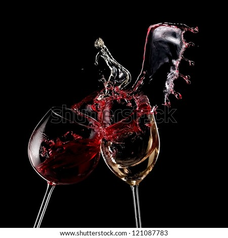 Red and white wine splash with drops - stock photo