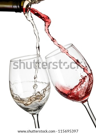 Red and white wine start to flow in two glasses - stock photo