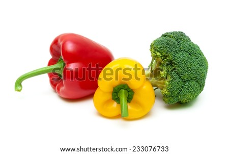 red and yellow bell peppers and broccoli isolated on white background close-up. horizontal photo. - stock photo