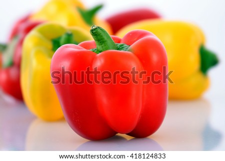 Red and yellow Capsicums over white background - stock photo