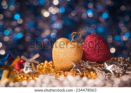 Red and yellow christmas heart toy. Abstract holiday background - stock photo
