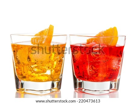 red and yellow cocktail with orange slice on top isolated on white background with space for text - stock photo