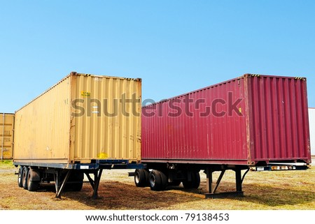 red and yellow container on truck trailer - stock photo